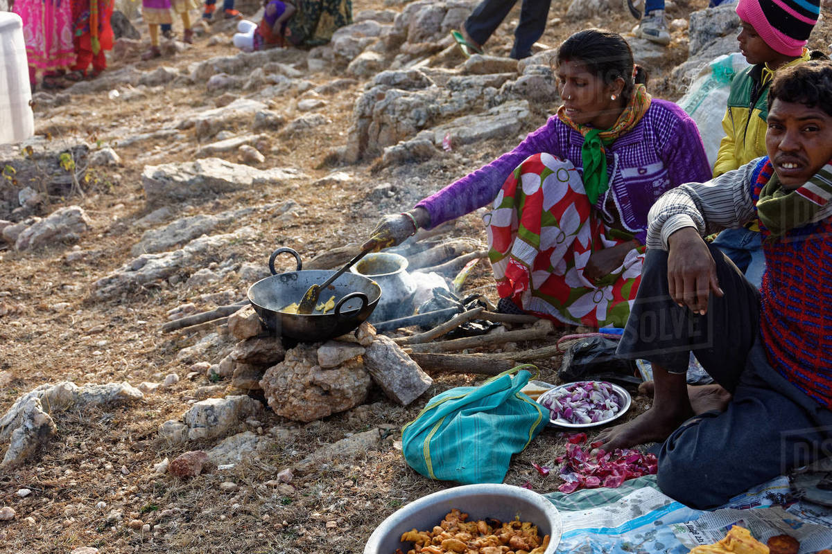 Indian lady and man are cooking street food to sell in rural fair. Royalty-free stock photo