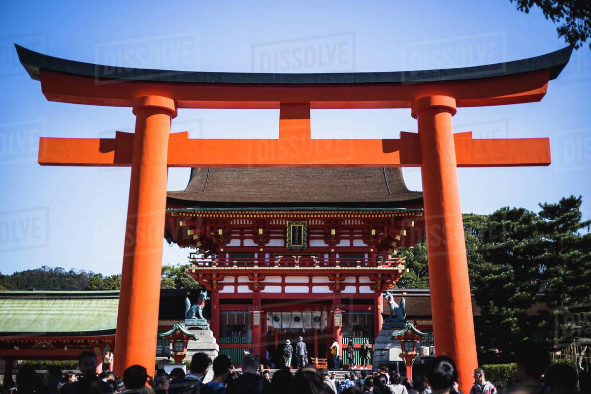 Tourists at a Large Torii Gate at Fushimi Inari Shrine in Kyoto, Japan Royalty-free stock photo