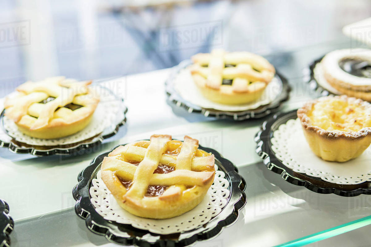 Jam tarts and rice puddings on showcase of a pastry shop Royalty-free stock photo