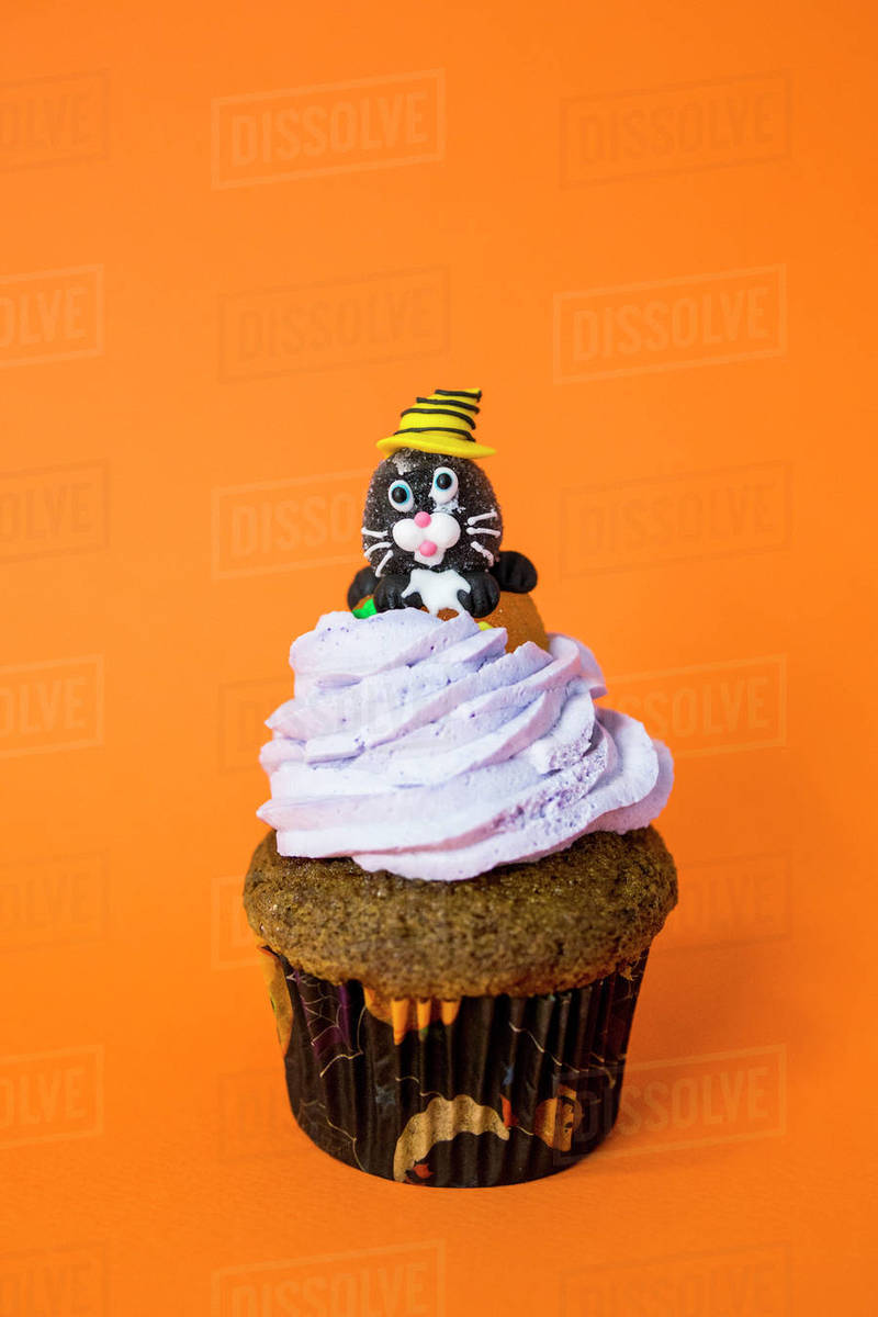 Nice halloween cupcake with a cheshire cat on butter cream Royalty-free stock photo