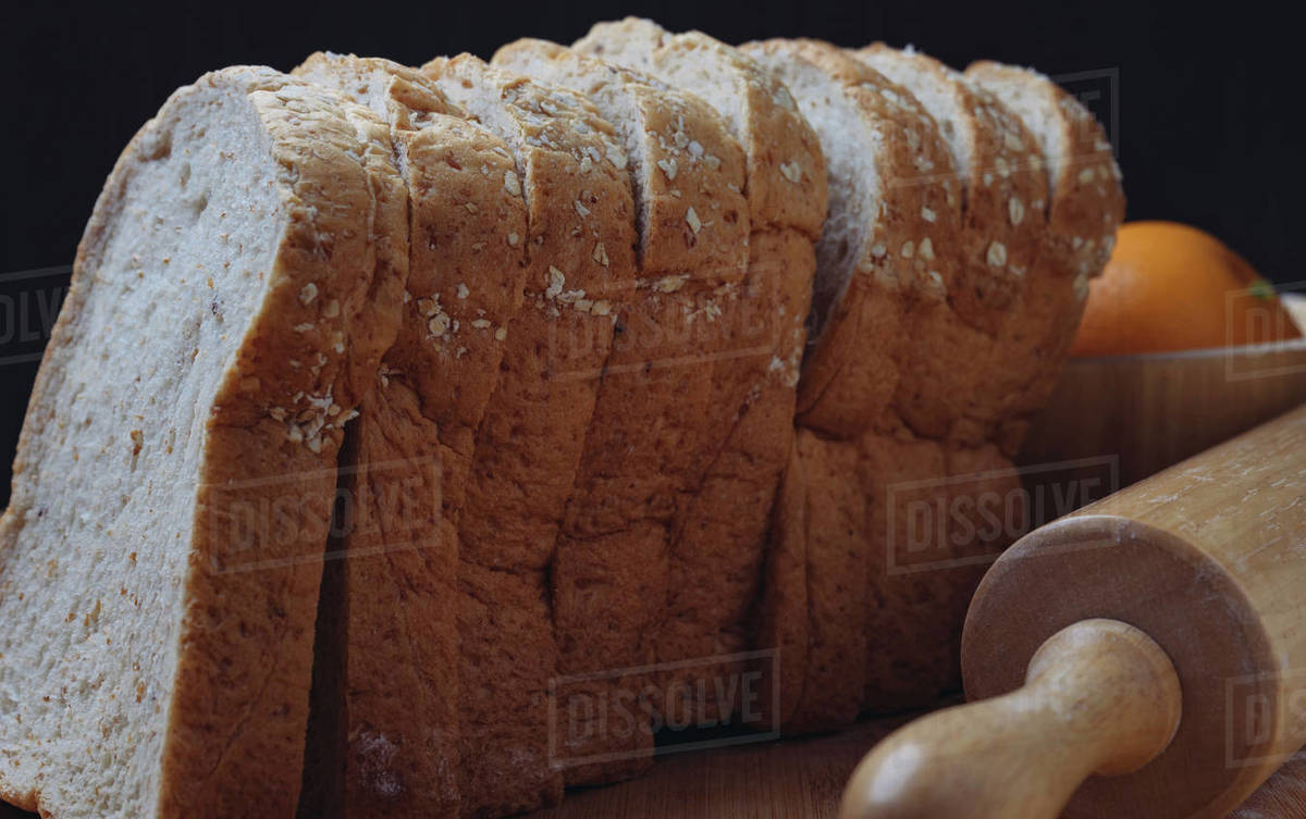 Whole wheat bread with rolling pin Royalty-free stock photo