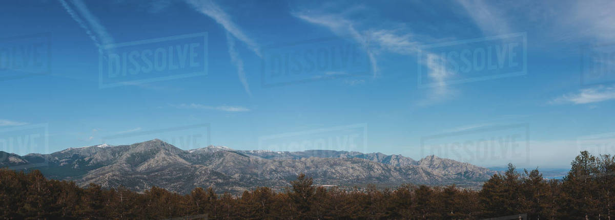Mountain chain in front of a large forest Royalty-free stock photo