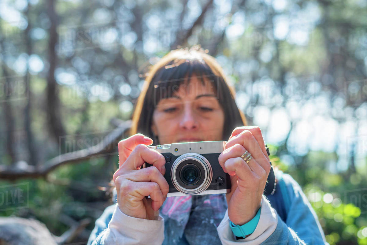 Portrait of young woman taking photos in autumn Royalty-free stock photo