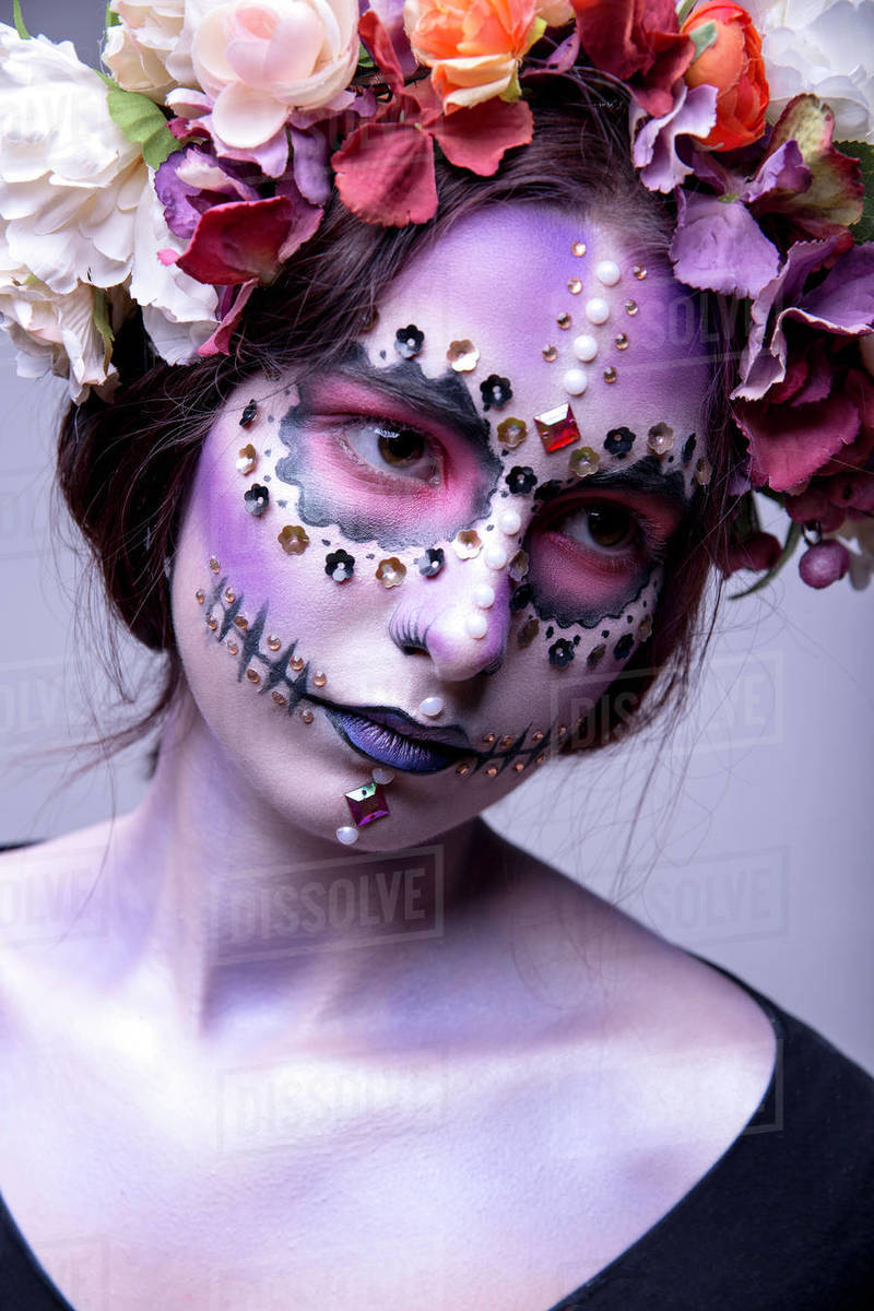 Halloween Model with Rhinestones and Wreath of Flowers Royalty-free stock photo