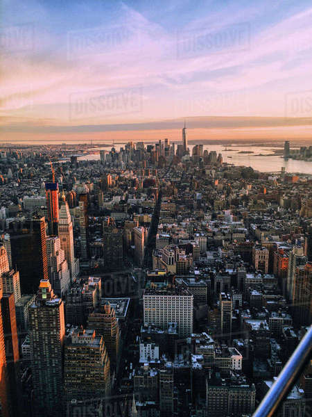 High angle view of cityscape against cloudy sky during sunset Royalty-free stock photo