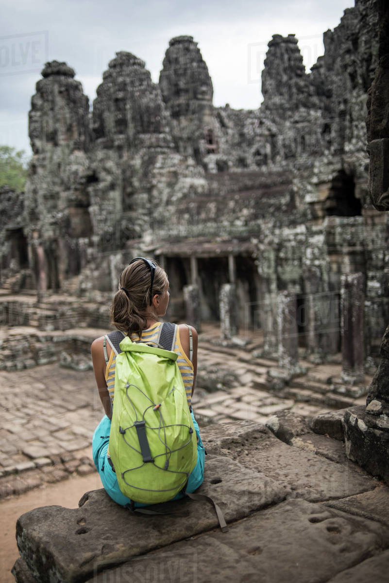 A female tourist at the Bayon, Ankor Thom temple, Angkor Wat, Siem Reap, Cambodia. Royalty-free stock photo