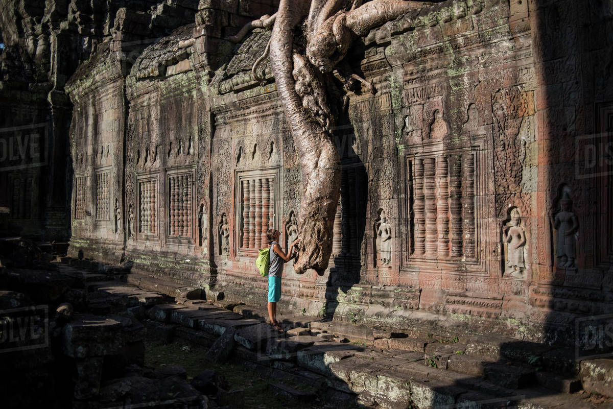 A female tourist in her visit of the View of the Preah Khan temple in the Angkor Wat Historical Site, Siem Reap, Cambodia. Royalty-free stock photo