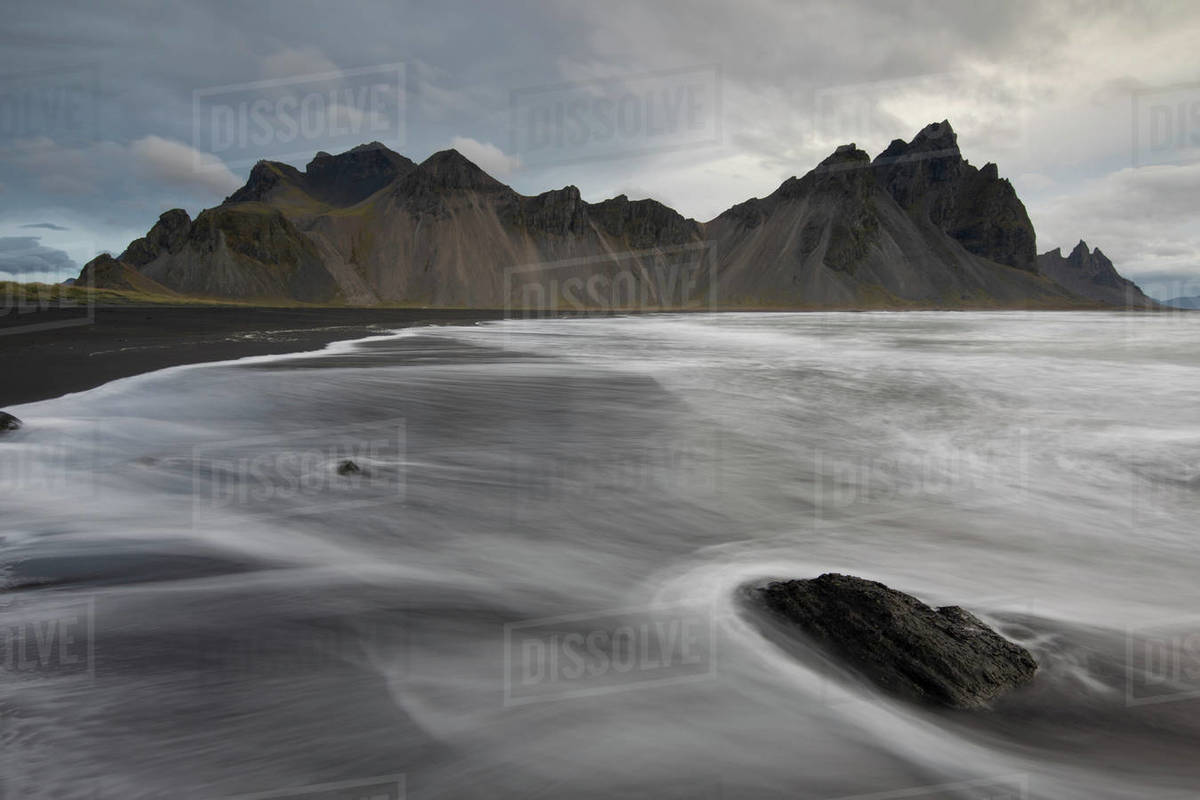 Sea foam on the rocks in Stokksnes, Vestrahorn, Iceland Royalty-free stock photo