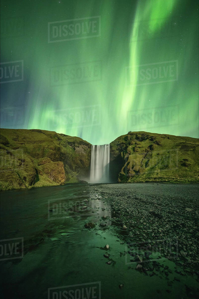 Northern Lights over Skogafoss waterfall Royalty-free stock photo