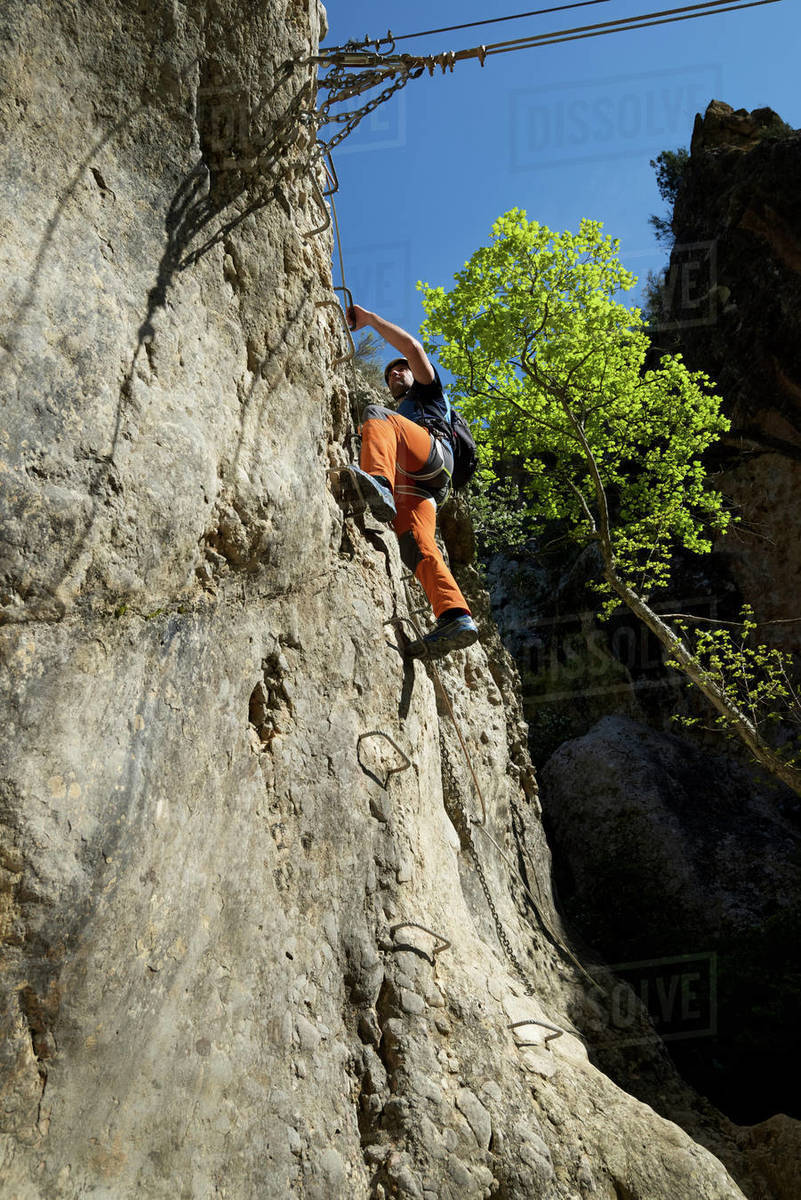 Climbing a ferrata route in Bierge in Guara Mountains. Royalty-free stock photo