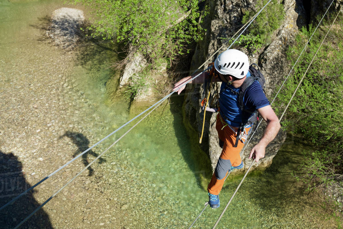 Crossing a suspension bridge in Bierge in Guara Mountains. Royalty-free stock photo