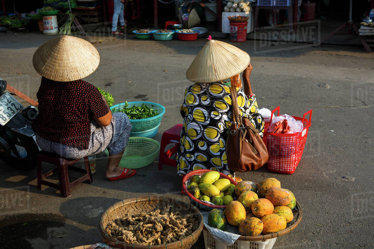 Fruit and Vegetable Vendors at a Market in Hoi An, Vietnam Royalty-free stock photo