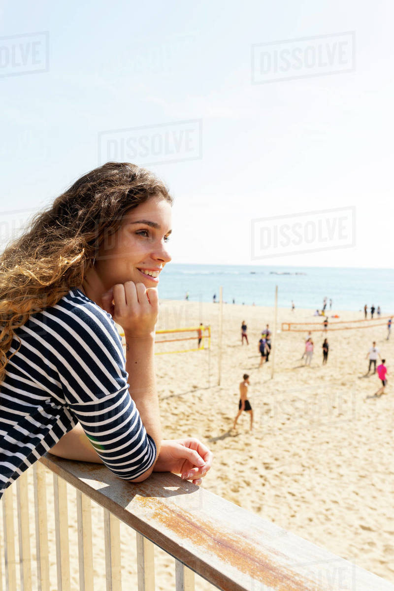Striped top young woman at the beach in barcelona Royalty-free stock photo