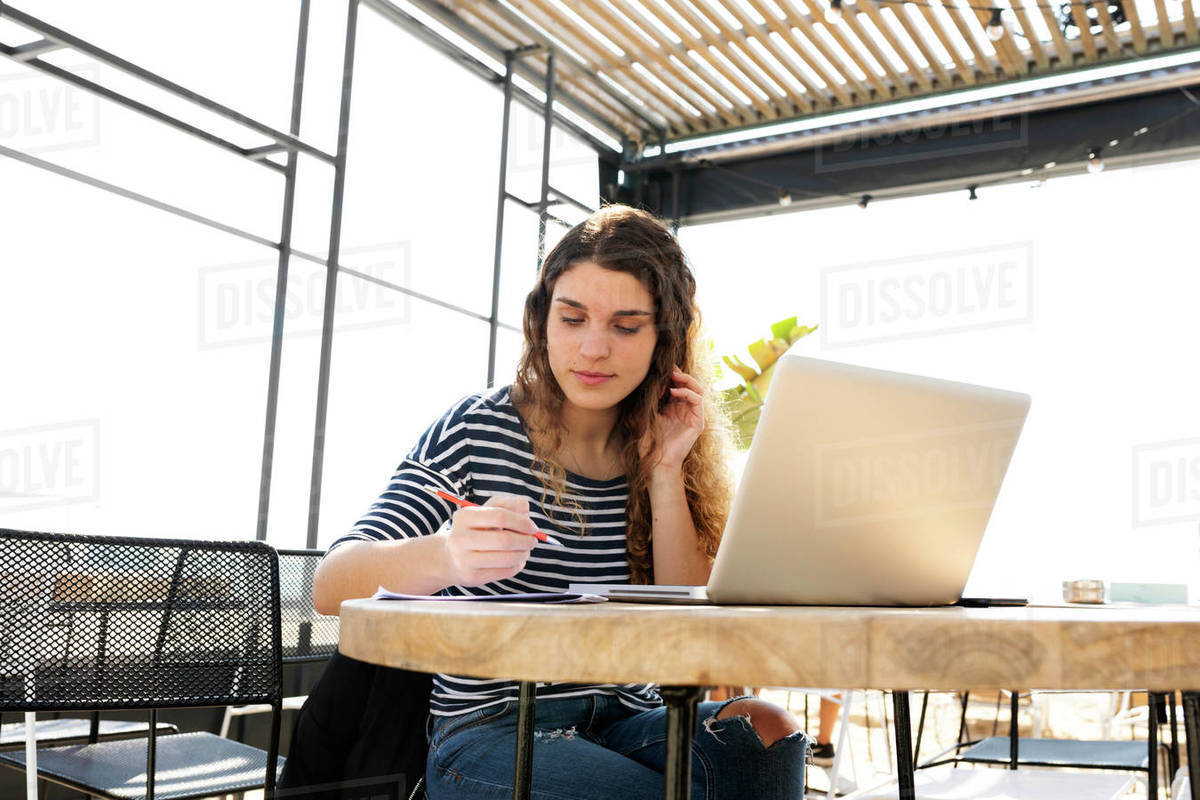 Caucasian woman writing in  Barcelona beach cafe Royalty-free stock photo