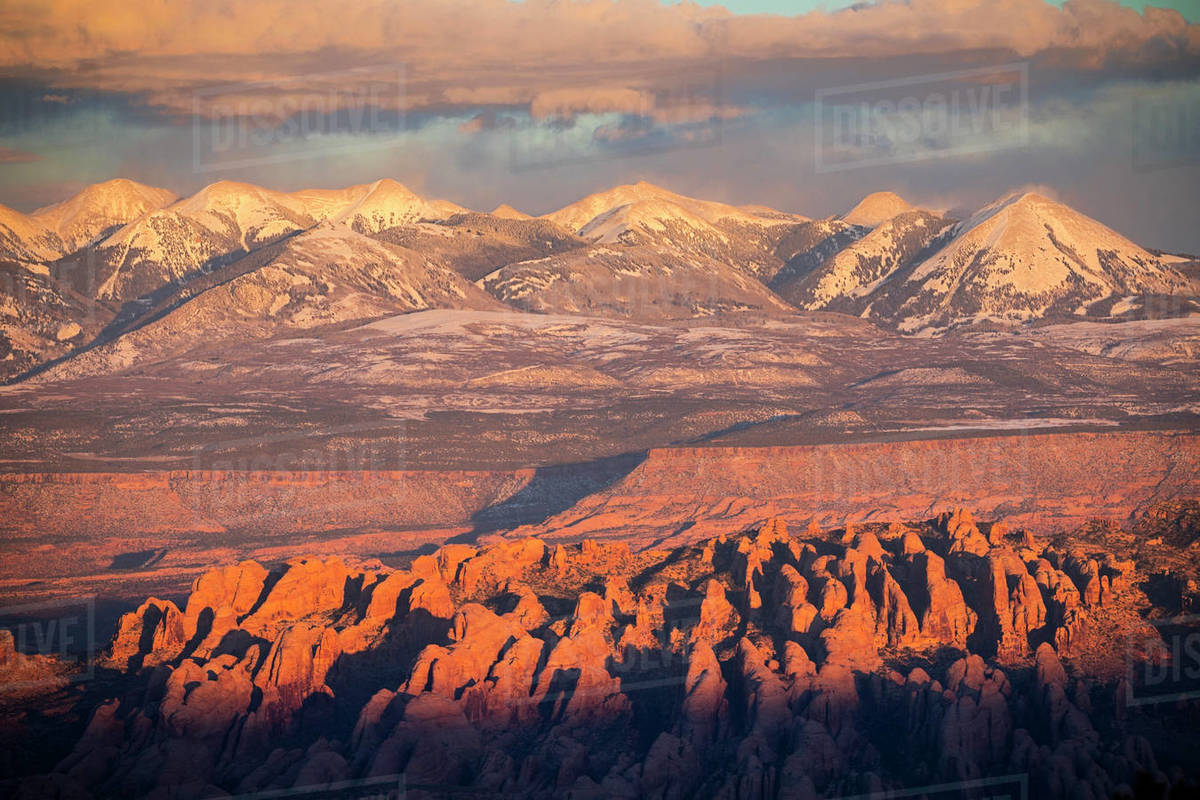 Landscape view of mountains and desert rock fins at sunset. Royalty-free stock photo