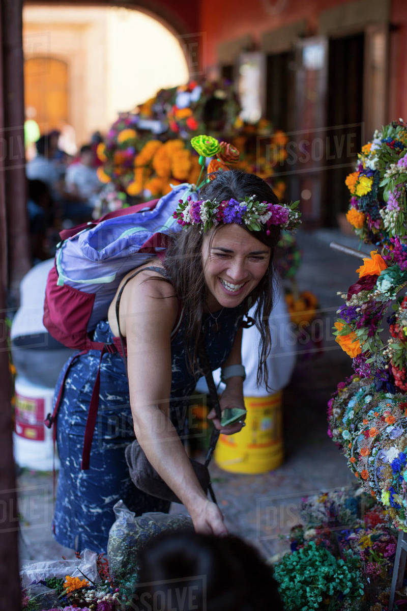 Woman traveling and buying flowers in San Miguel de Allende, Mexico Royalty-free stock photo