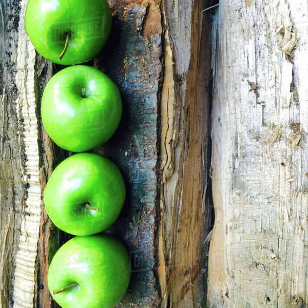 Overhead view of Granny Smith apples on broken table Royalty-free stock photo