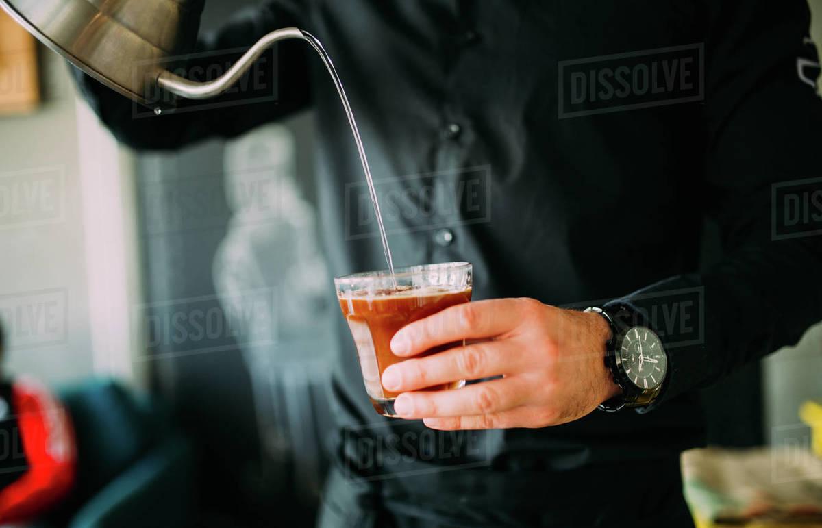 Barista making latte in restaurant Royalty-free stock photo
