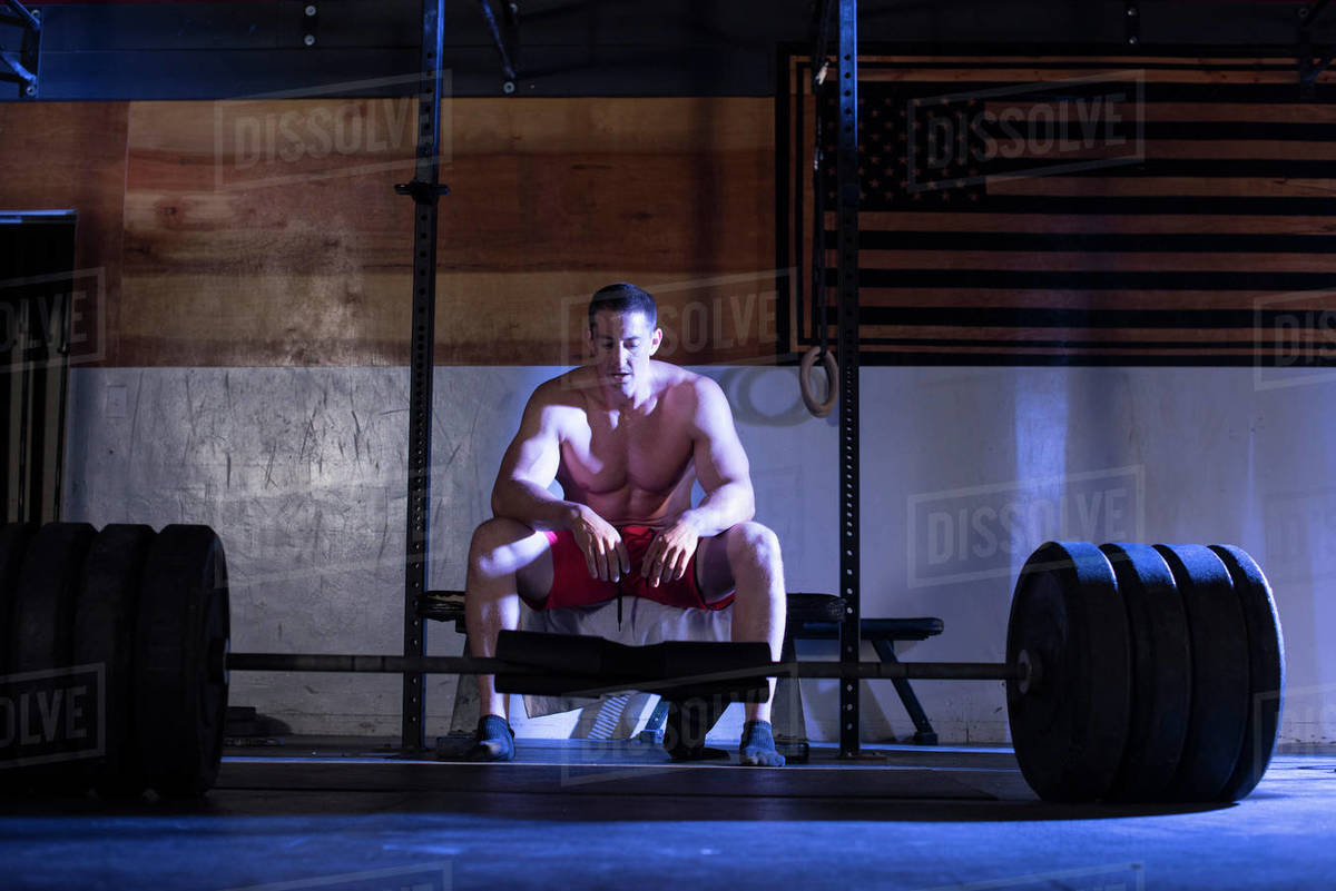An athlete takes a rest before deadlifting. Royalty-free stock photo