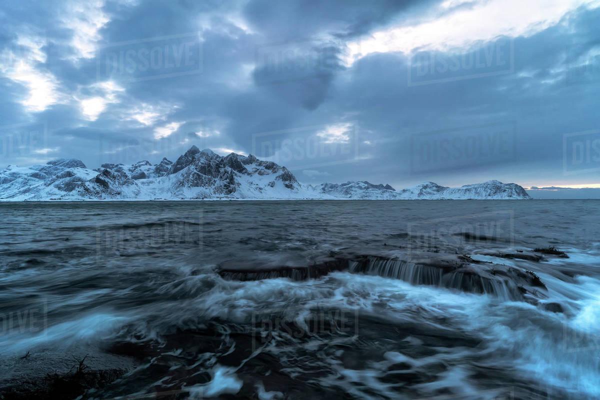 Clouds on waves crashing on rocks, Vareid, Flakstad, Norway Royalty-free stock photo