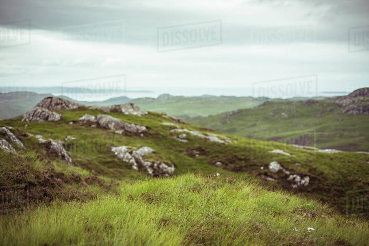 Landscape scottish highlands ocean wild green grass and stone Royalty-free stock photo