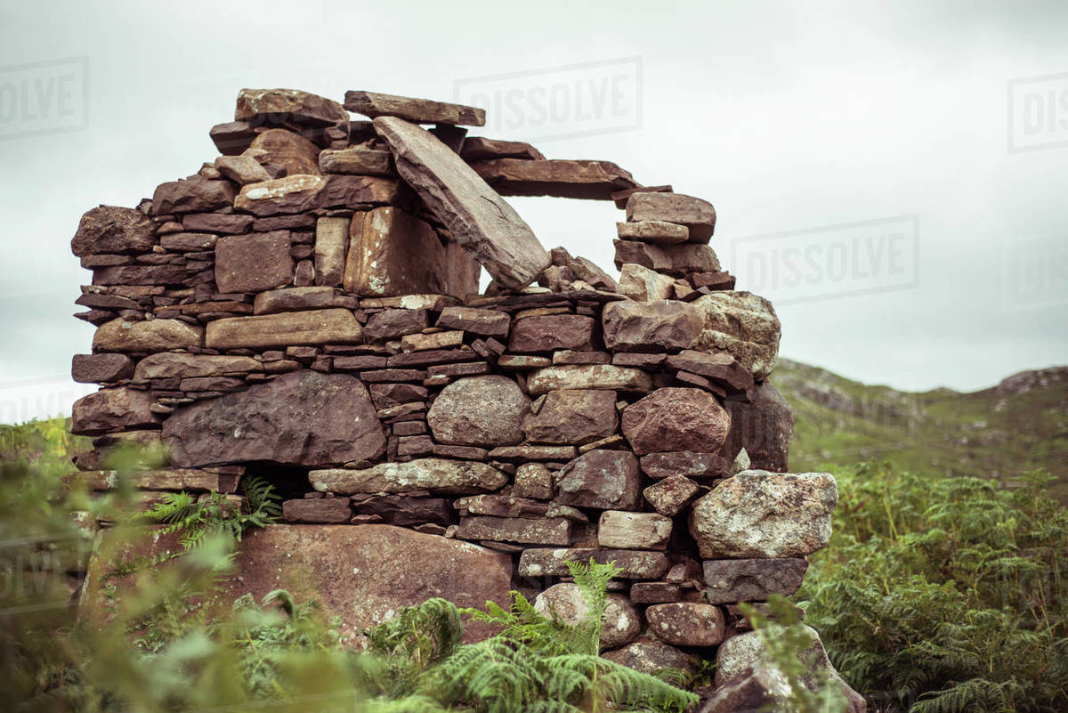 Stone ruins of old village in Scottish highlands in mountains Royalty-free stock photo