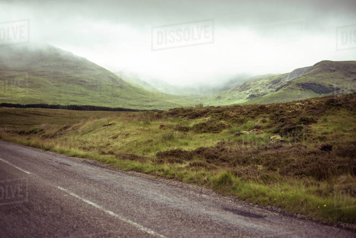 Road through misty mountains Royalty-free stock photo