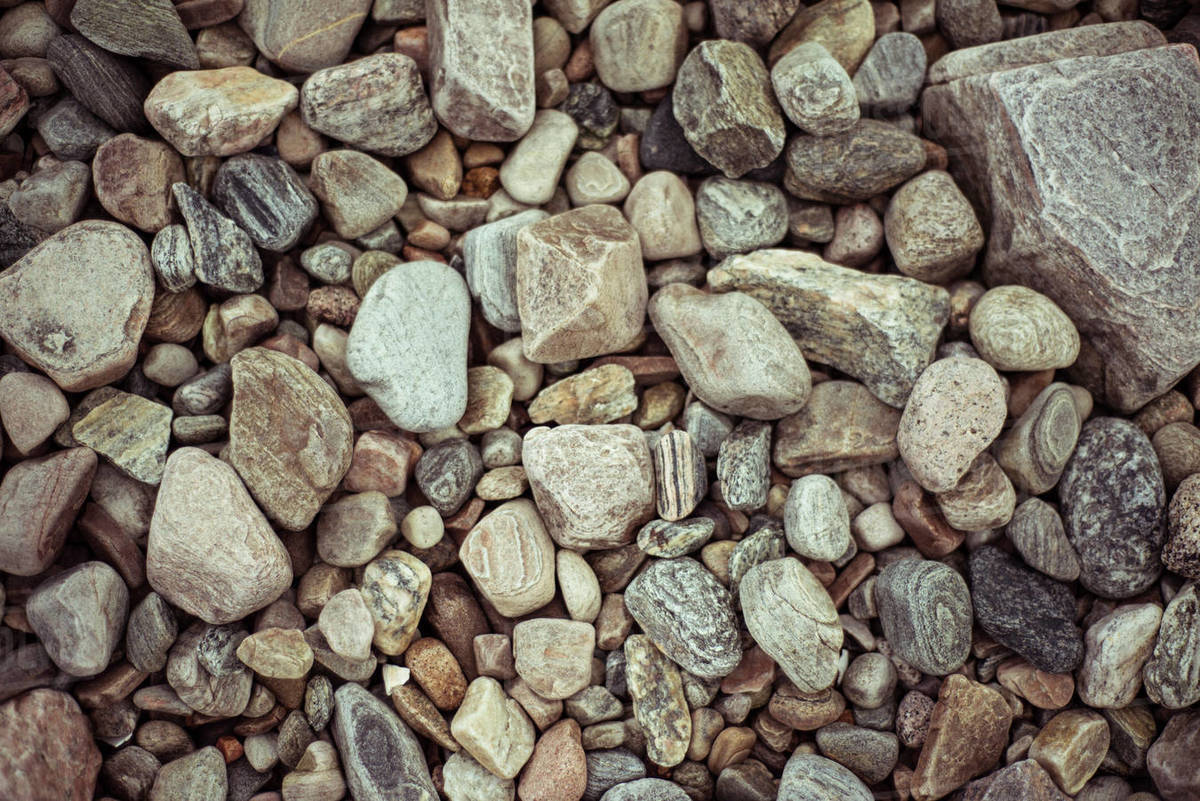 Flat lay birds eye of pretty pebbles and stones on beach Royalty-free stock photo