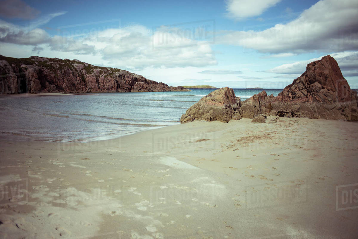 Wide angle shot of blue water beach Royalty-free stock photo