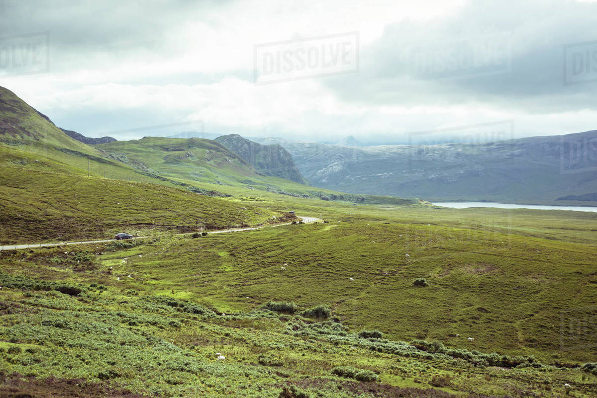 Road winds through remote mountains Royalty-free stock photo