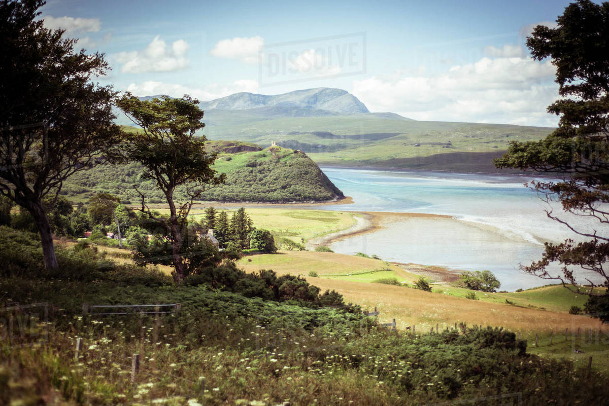 Sunny happy view of pretty countryside and castle on hill Royalty-free stock photo