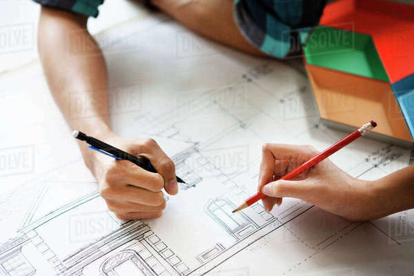 Cropped image of couple examining blueprint at home Royalty-free stock photo