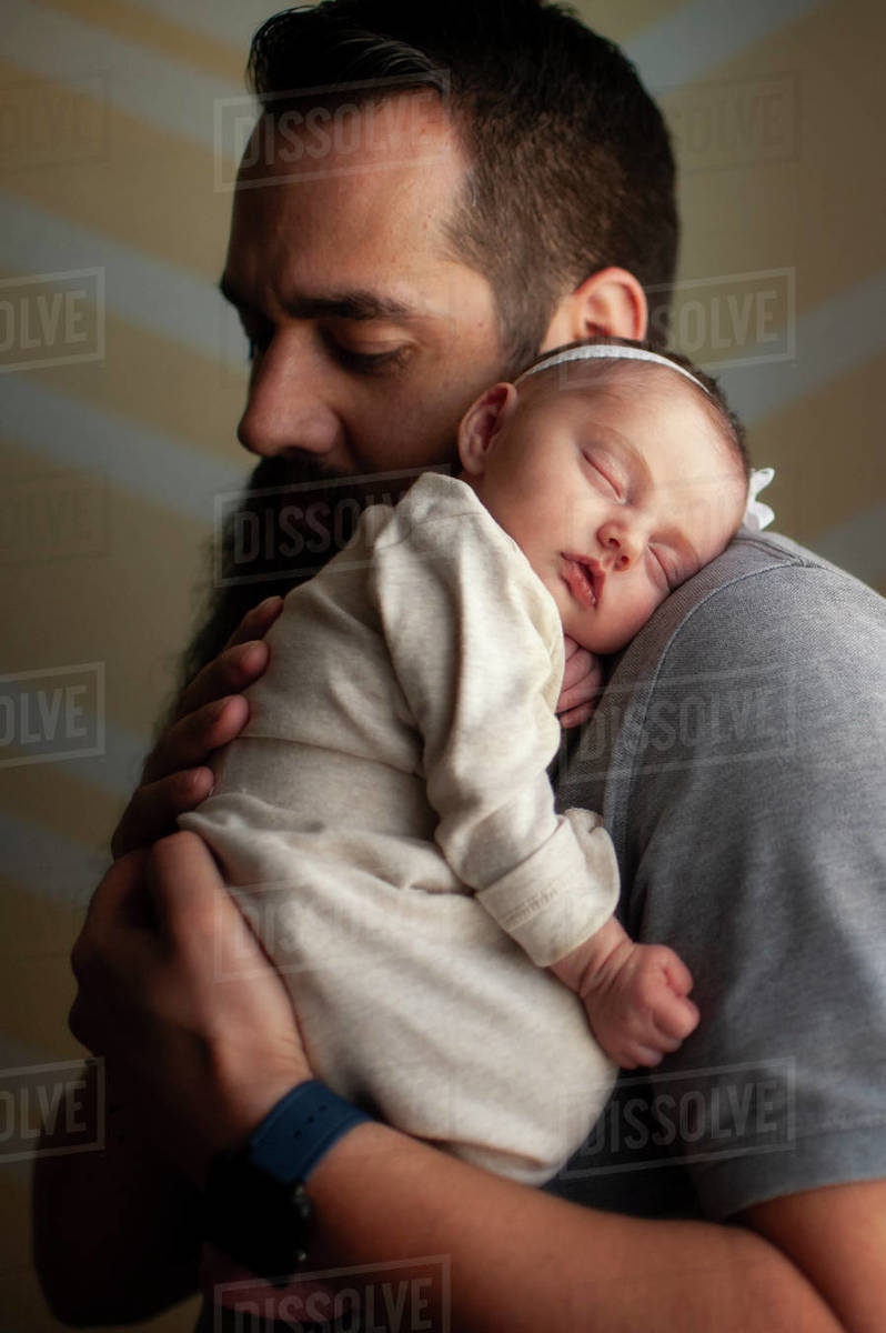 Newborn Baby Girl Sleeping On Father S Shoulder At Home In Soft Light Stock Photo Dissolve