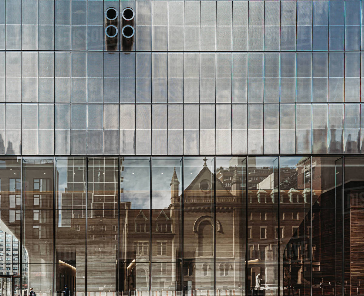Reflection of old buildings in modern glass one in New York City, USA. Royalty-free stock photo