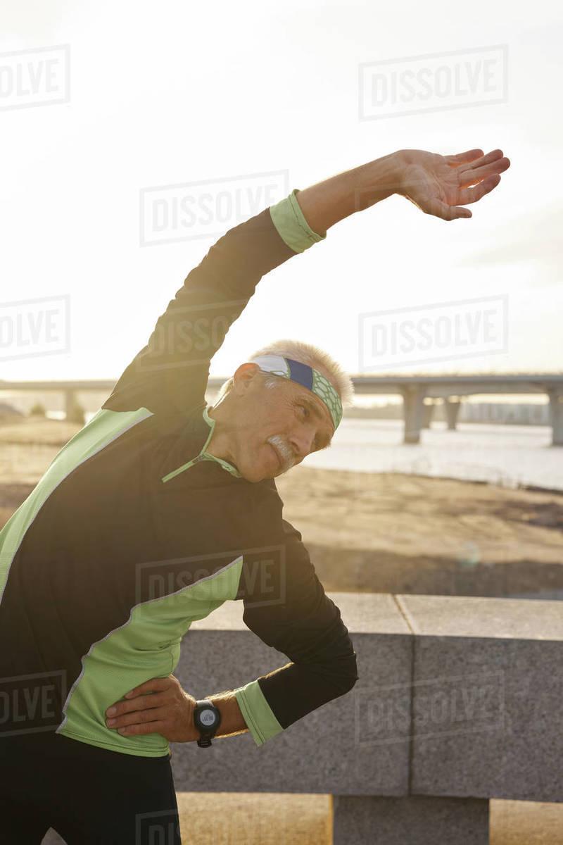 Caucasian Man Doing Bending Exercise Royalty-free stock photo