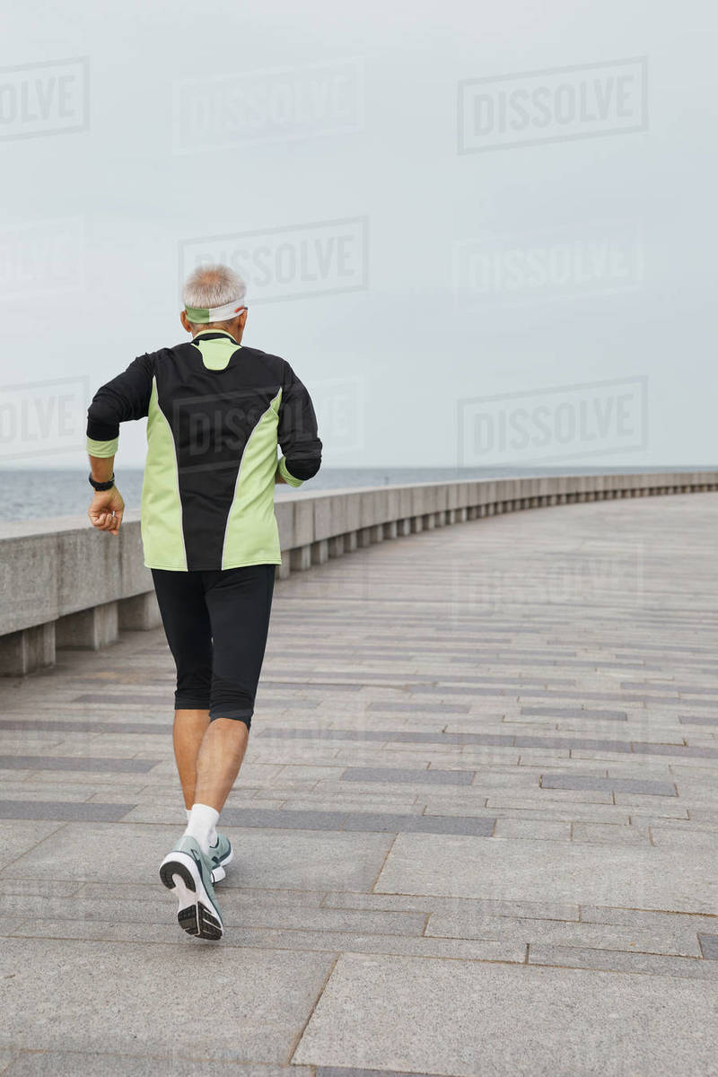 Unrecognizable Aged Man Running Royalty-free stock photo