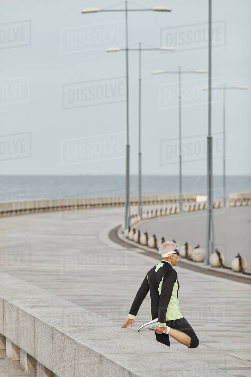 Unrecognizable Man Doing Leg Stretching Exercise Outdoors Royalty-free stock photo