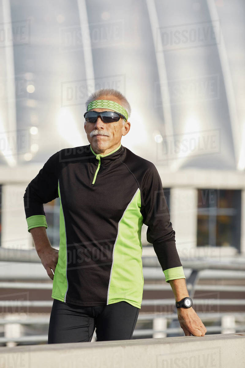 Aged Man In Tracksuit During Workout Royalty-free stock photo