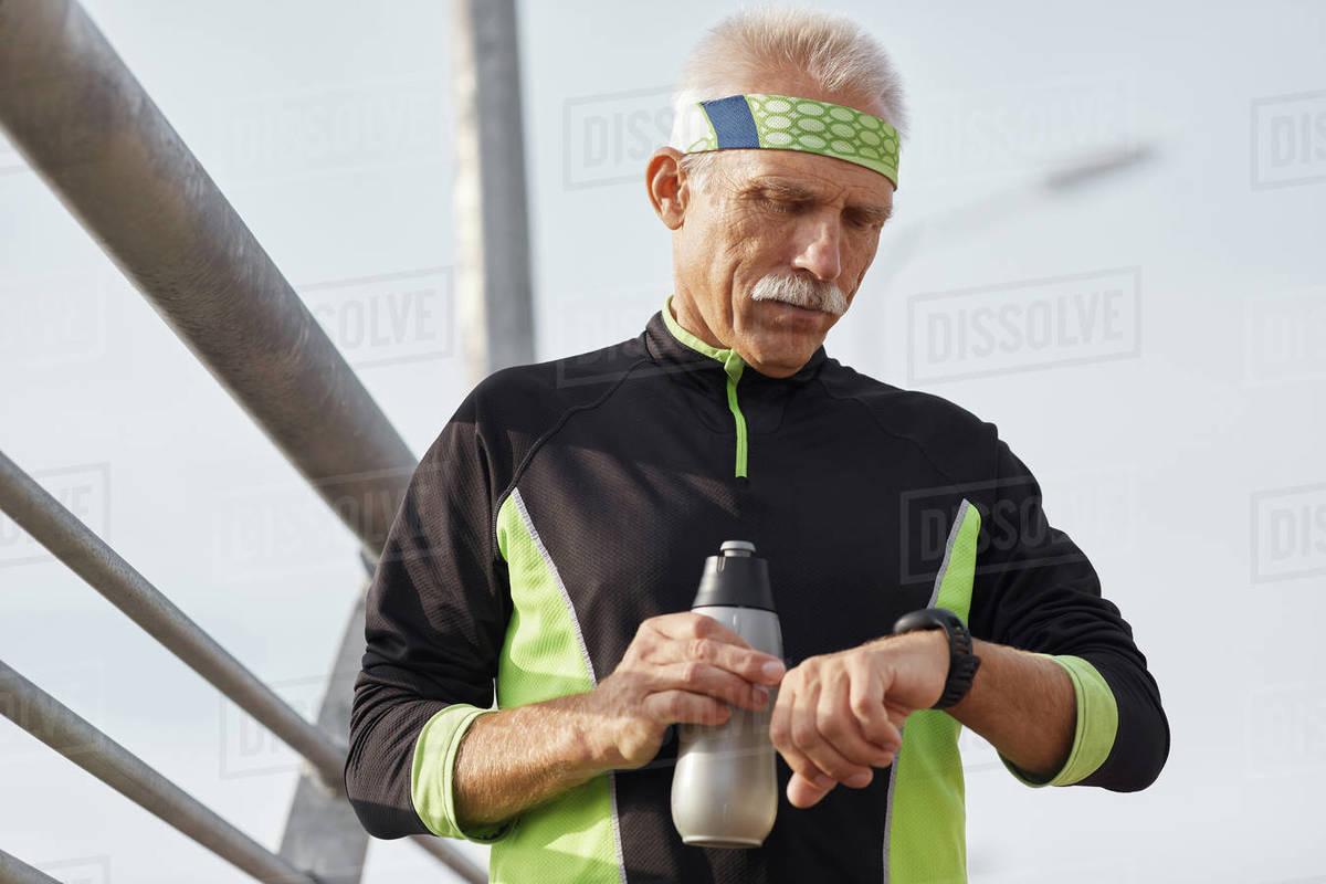 Senior Sportsman Checking Time Royalty-free stock photo
