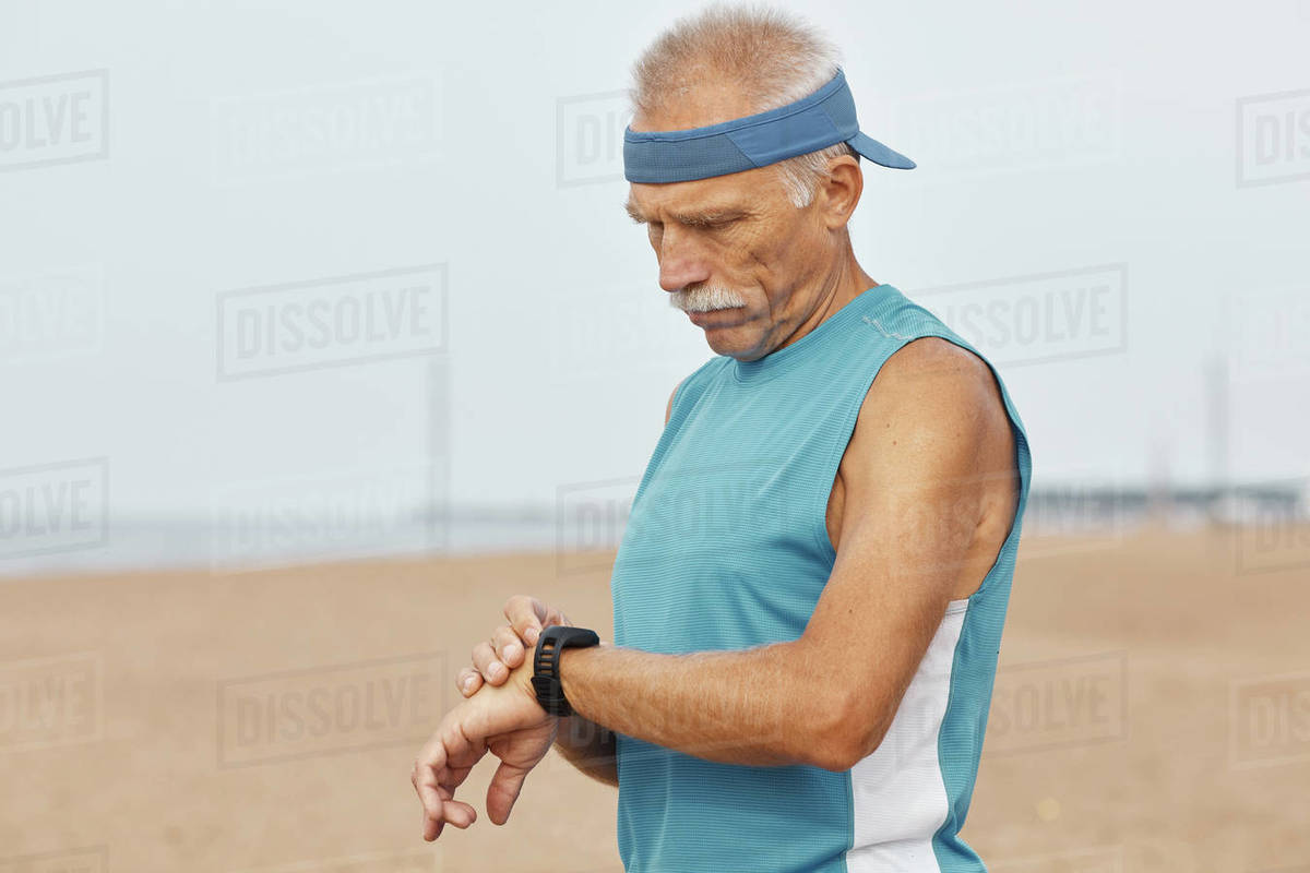 Modern Aged Man With Fitness Bracelet Royalty-free stock photo