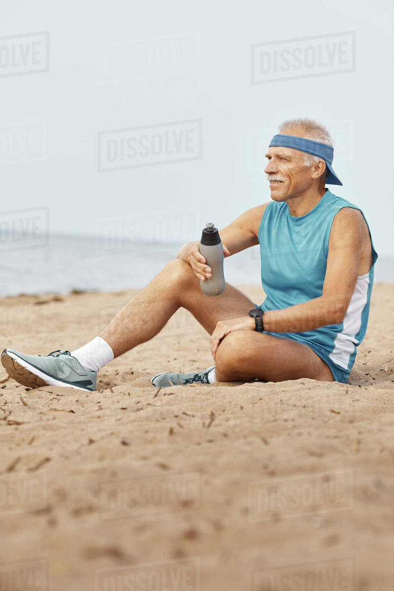 Sporty Senior Man Relaxing With Bottle Of Water Royalty-free stock photo