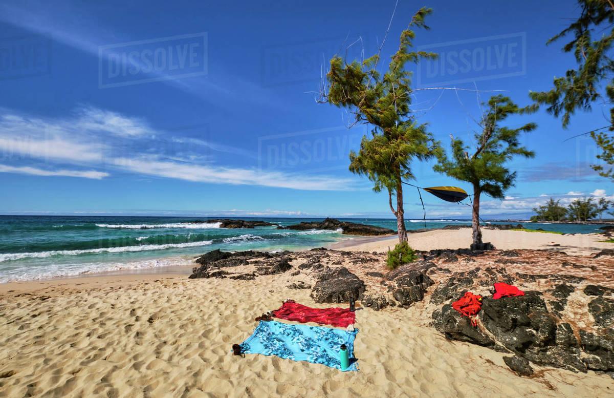 A hammock flies in the wind on Makalawena Beach on the Big Island Royalty-free stock photo