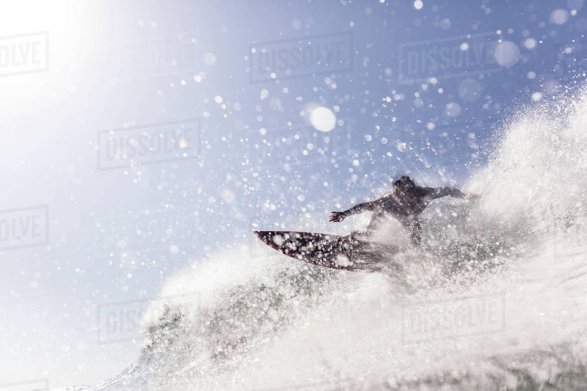 Low angle view of man surfing in sea against sky Royalty-free stock photo