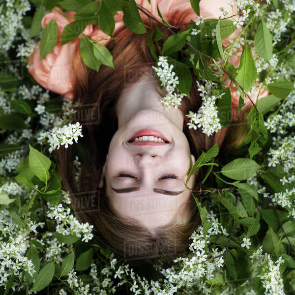 Overhead view of woman lying amidst plants Royalty-free stock photo