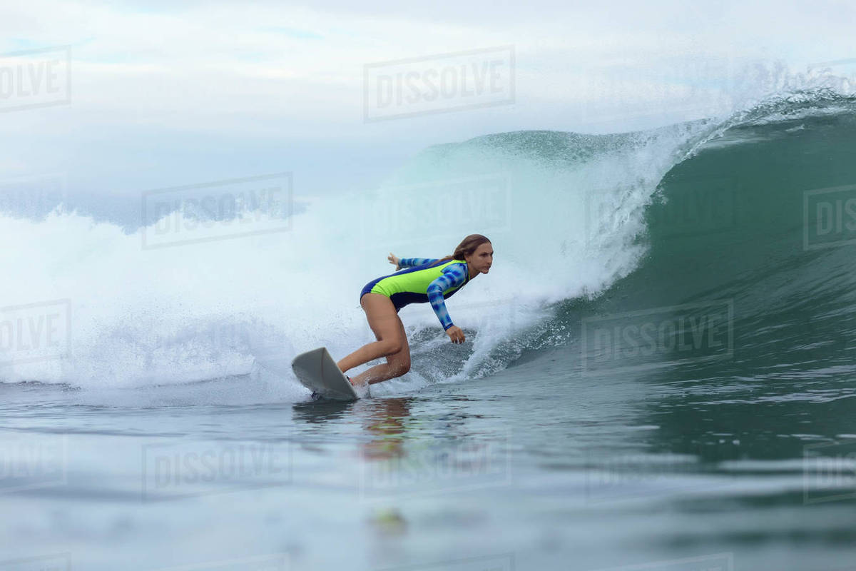 Side View Of Woman Surfing On Sea Stock Photo