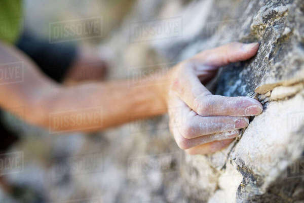 Cropped image of man climbing rock Royalty-free stock photo