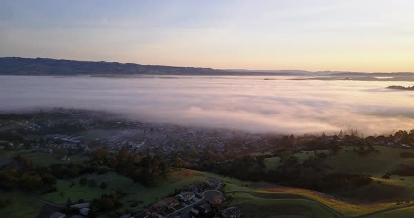 Drone shot of Petaluma covered in fog Royalty-free stock video