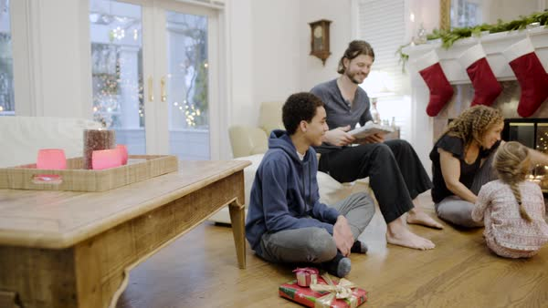 Medium shot of a family giving gifts at Christmas Royalty-free stock video