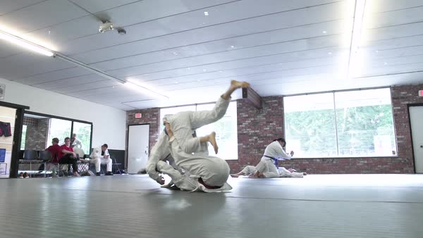 Young women doing Jiu-jitsu Royalty-free stock video