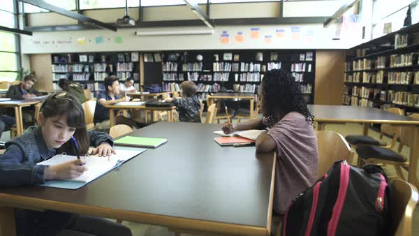 Wide shot of students in high school library Royalty-free stock video